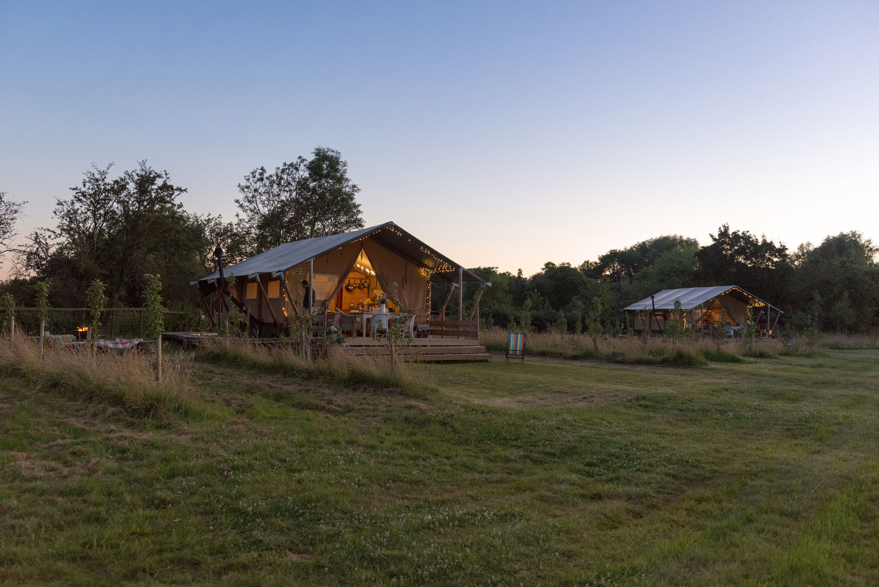 Upsticks glamping lodges at dusk